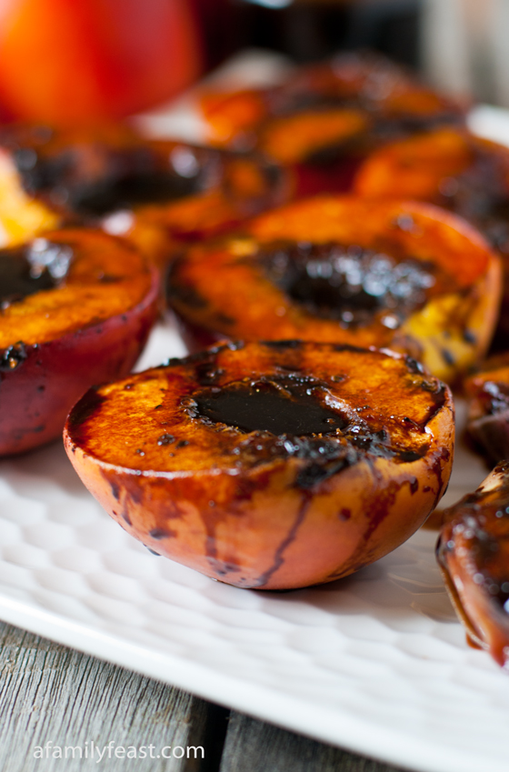 An amazingly delicious recipe for Grilled Balsamic Peaches. A reduction of molasses, balsamic vinegar and fresh black pepper is fabulous with the sweetness of grilled peaches.