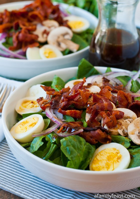 A delicious Spinach Salad recipe with an amazing Warm Bacon Dressing.