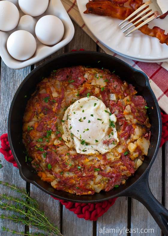 Corned Beef Breakfast Hash - Great for a brunch crowd or holiday breakfast. Flavorful combination of corned beef, white and sweet potatoes, and leeks for a ton of flavor!