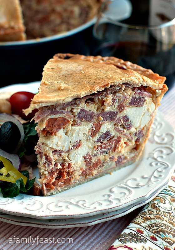 A classic Italian recipe for Easter Pie (Pizza Giana) - a dense, delicious pie filled with Italian Meats and Cheeses with a thick crust.