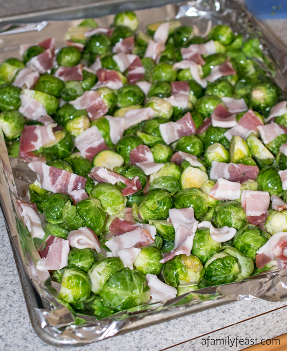 Oven Roasted Brussels Sprouts with Bacon - A simple and super flavorful recipe! Perfect side dish for a special holiday meal.