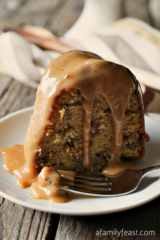 Toffee Pecan Bundt Cake with Caramel Drizzle recipe - A moist and delicious cake that is filled with toffee bits and pecans with an amazing caramel drizzle frosting!