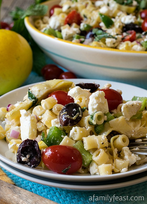 Mediterranean Pasta Salad - Classic Greek flavors and ingredients combined into a delicious pasta salad. The dressing in this recipe is not to be missed!
