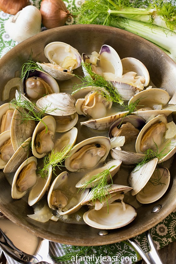 Littlenecks in Fennel Broth - A simple and delicious seafood appetizer. The fennel in this broth adds unexpected flavor that goes perfectly with the seafood!