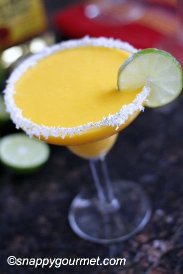 This frozen mango coconut margarita is one of over 30 refreshing margarita recipes in a collection on afamilyfeast.com