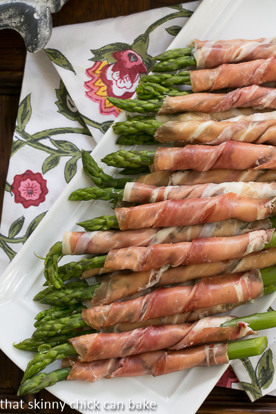 Prosciutto Wrapped Asparagus - One of over 30 Amazing Asparagus Recipes to give you cooking inspiration this Spring! See the collection on A Family Feast
