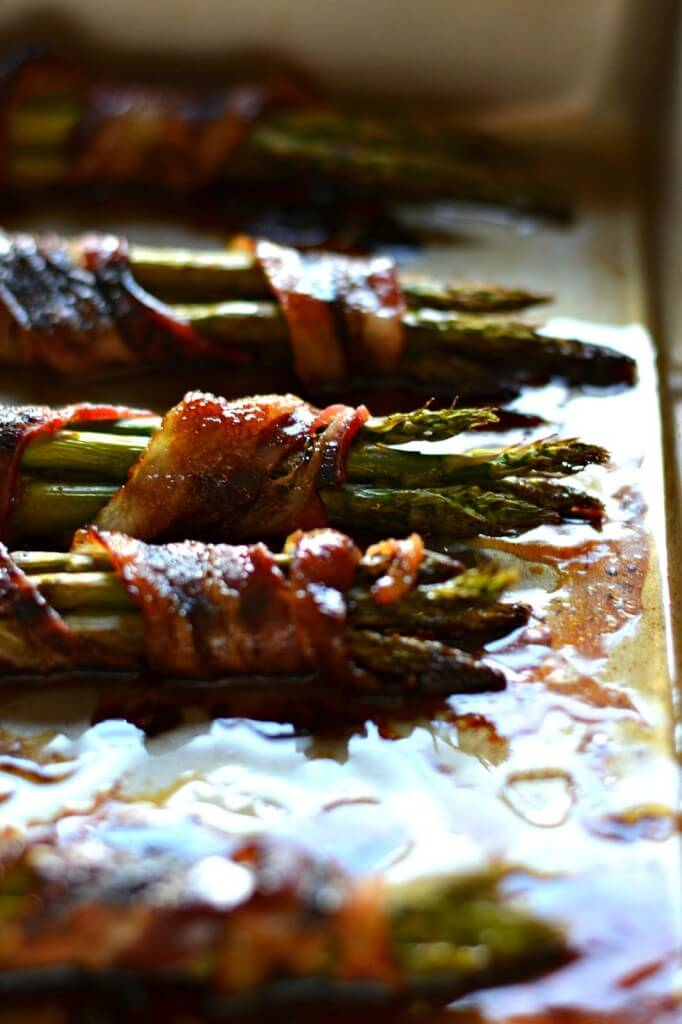 Bacon Wrapped Asparagus - One of over 30 Amazing Asparagus Recipes to give you cooking inspiration this Spring! See the collection on A Family Feast